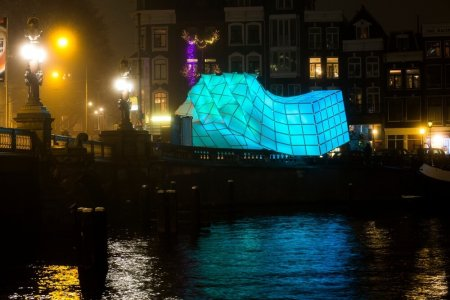 """The """"Eye Beacon"""" in Amsterdam in turquoise at night."""