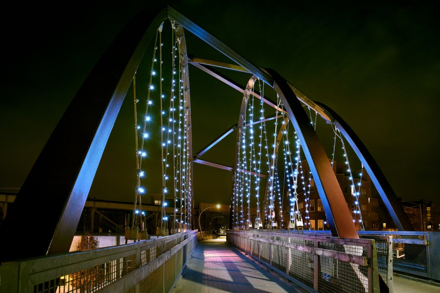An illuminated bridge as a light art installation in Chicago