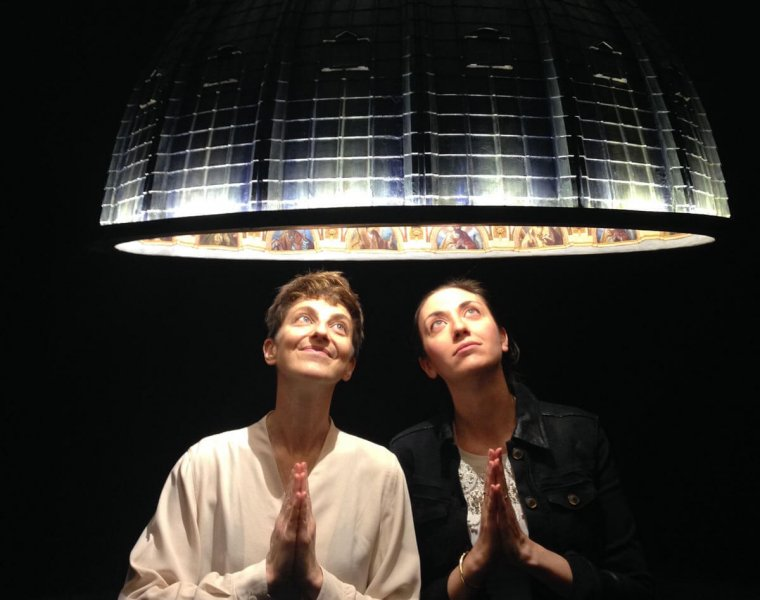 The two artists under the pendant lamp