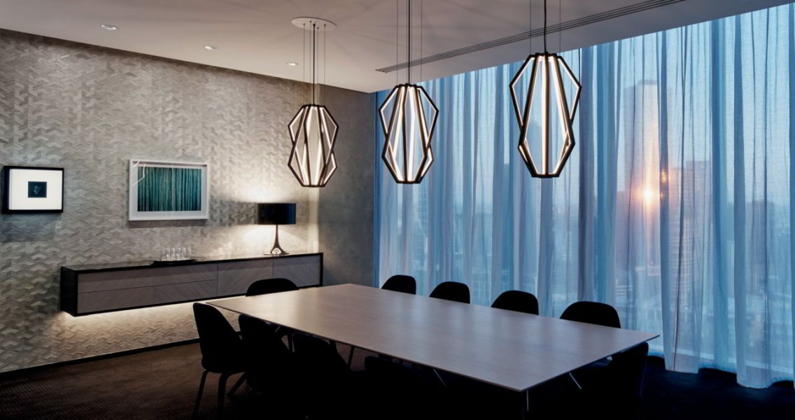 "The ""appeal"" of the custom designed, geometrically symbolic pendant luminaire in specific rooms and sections in the law firm is extremely effective."